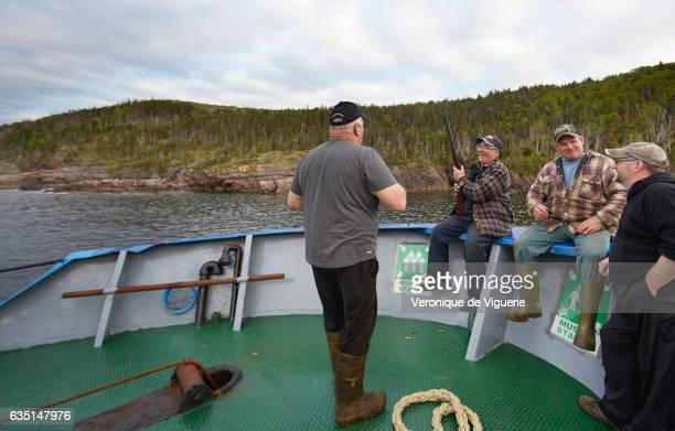 Captain Ed Kean Captain Nelson Pittman engineer Philip Kennedy and the Cook Austin Randell are shooting at some birds to eat As more icebergs drift...