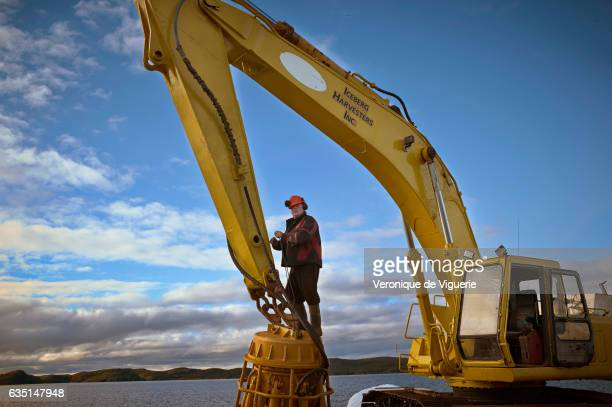Captain Ed Kean is trying to repair the grabber As more icebergs drift south due to climate change a few enterprising seafarers have begun harvesting...