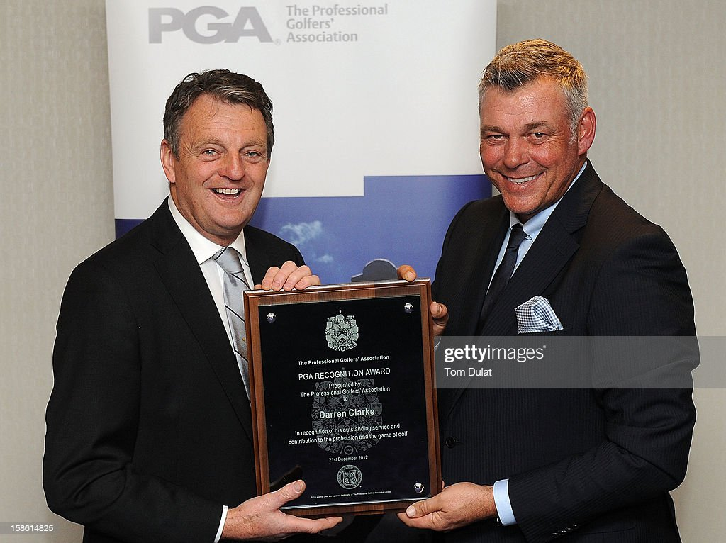 PGA Captain Eddie Bullock (L) gives a plaque to <a gi-track='captionPersonalityLinkClicked' href=/galleries/search?phrase=Darren+Clarke&family=editorial&specificpeople=171309 ng-click='$event.stopPropagation()'>Darren Clarke</a> (R) during the PGA Lunch on December 21, 2012 in London, England.