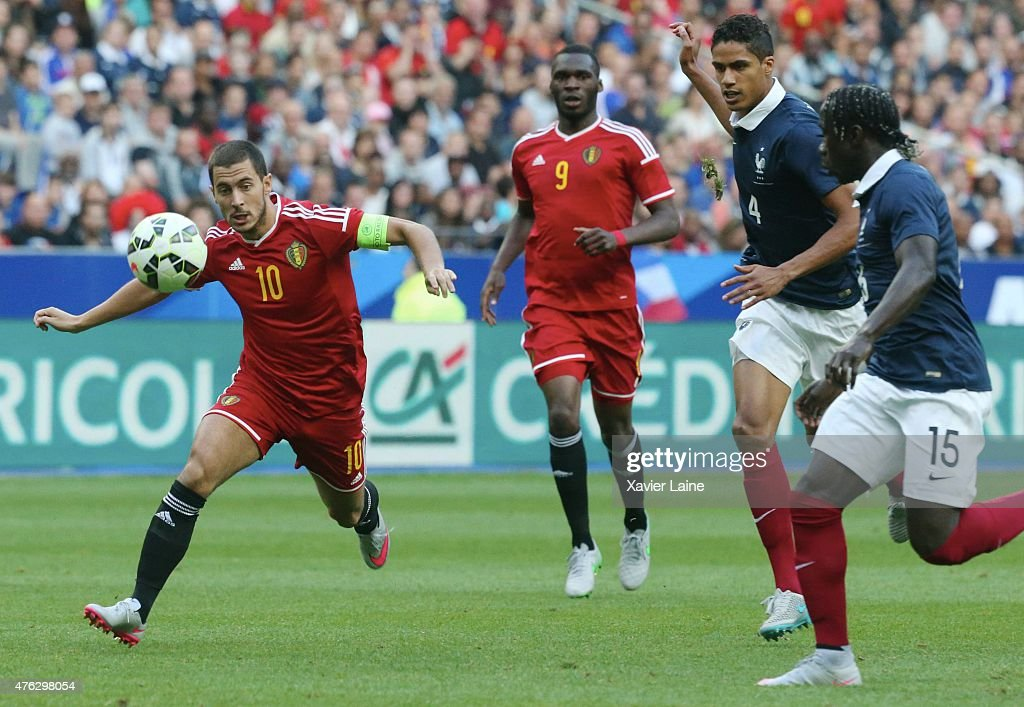 Captain Eden Hazard #10 of Belgium in action with Raphael Varane #4 and Bacary Sagna #15 of France during the International Friendly games between France and Belgium at Stade de France on june 7, 2015 in Paris, France.