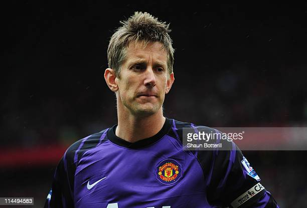 Captain Edwin van der Sar of Manchester United looks on for his final league match prior to the Barclays Premier League match between Manchester...