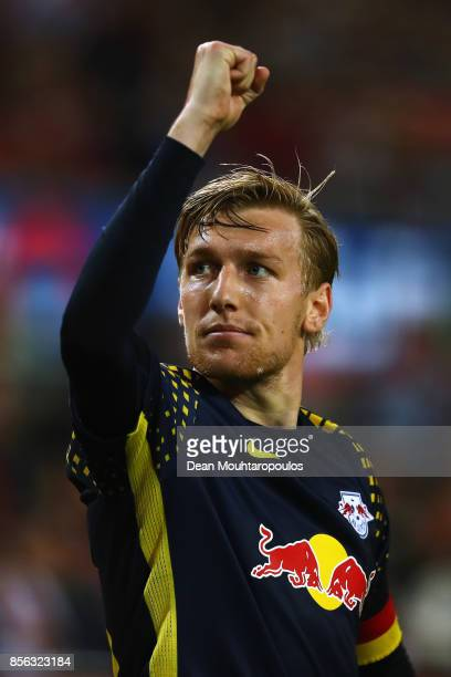 Captain Emil Forsberg of RB Leipzig celebrates with the fans after victory in the Bundesliga match between 1 FC Koeln and RB Leipzig at...