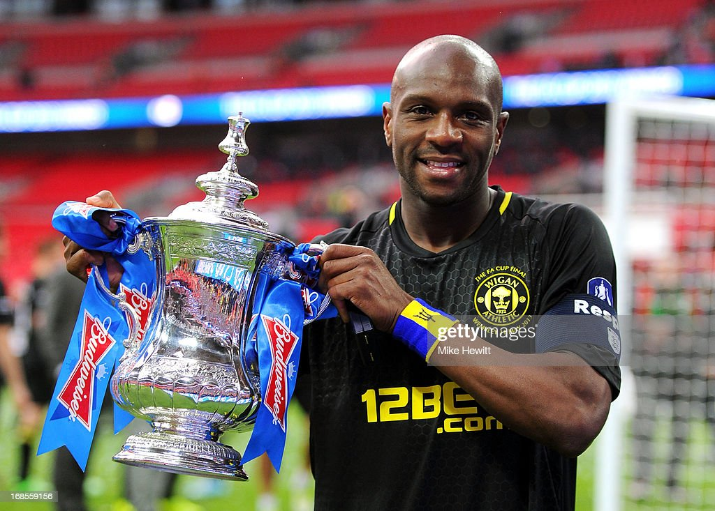 Captain Emmerson Boyce of Wigan Athletic celebrates with the trophy following his team's 1-0 victory during the FA Cup with Budweiser Final between Manchester City and Wigan Athletic at Wembley Stadium on May 11, 2013 in London, England.
