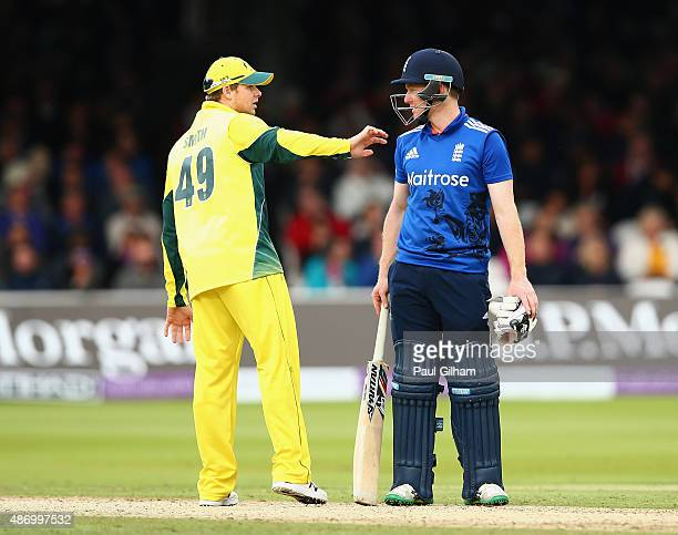 Captain Eoin Morgan of England argues with Captain Steven Smith of Australia after Ben Stokes of England was given out for obstruction after Mitchell...