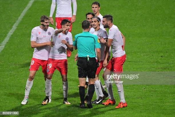 Captain Fethi Harek of Nimes complains to referee Jeremy Stinat after his team's injury time equaliser is disallowed for offside during the Ligue 2...