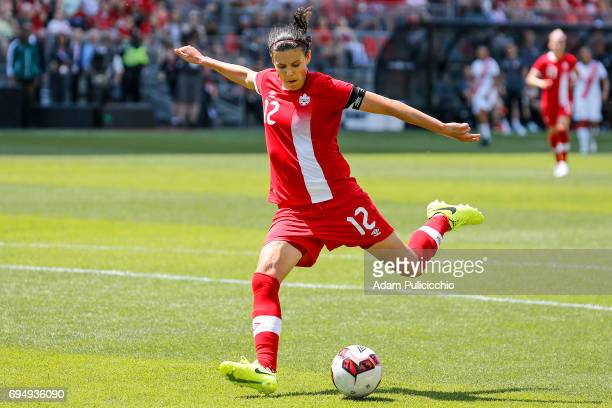 Captain Forward Christine Sinclair of Team Canada blasts the ball inside the 18 yard box against Team Costa Rica in a exhibition match on June 11...