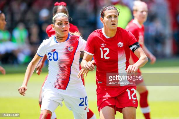 Captain Forward Christine Sinclair of Team Canada fights for position against Defender Wendy Acosta of Team Costa Rica in a exhibition match on June...