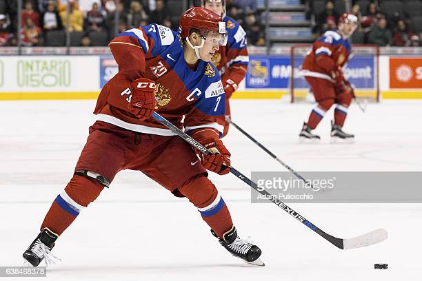 Captain forward Kirill Kaprizov of Team Russia sets up a play against Team Slovakia in a preliminary round Group B game during the IIHF World Junior...