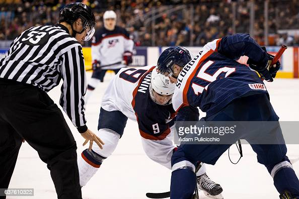 Captain forward Luke Kunin of Team United States battles in a faceoff against forward Marek Sloboda of Team Slovakia in a preliminary round Group B...