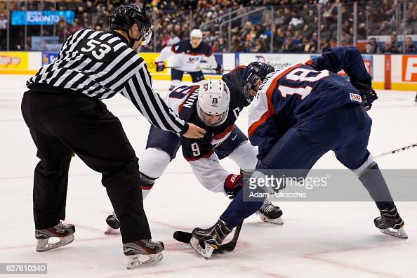 Captain forward Luke Kunin of Team United States gets ready for a faceoff against forward Boris Sadecky of Team Slovakia in a preliminary round Group...