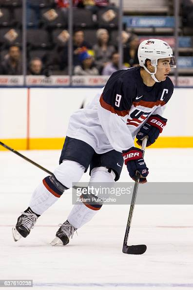 Captain forward Luke Kunin of Team United States skates through the neutral zone while looking to move the puck against Team Slovakia in a...