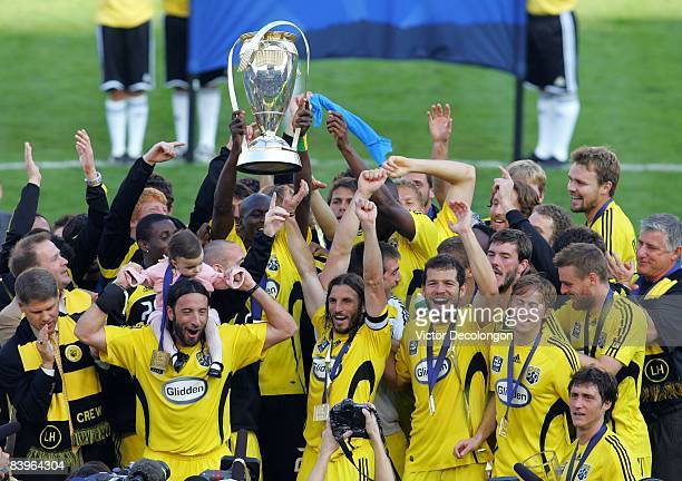 Captain Frankie Hejduk and his Columbus Crew teammates hold up the Philip F Anschutz Trophy in celebration after defeating the New York Red Bulls 31...