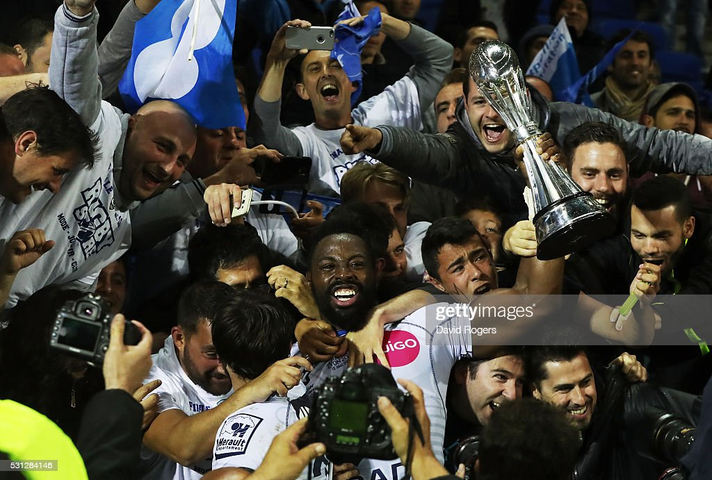 Captain Fulgence Ouedraogo of Montpellier celebrates with the trophy and fans follwoing their team's 2619 victory during the European Rugby Challenge...