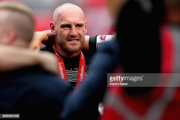 Captain Gareth Ellis talks during a team huddle after winning during Hull FC v Wigan Warriors in the Ladbrokes Challenge Cup at Wembley Stadium on...