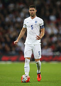 Captain Gary Cahill of England in action during the UEFA EURO 2016 Group E Qualifier match between England and Estonia at Wembley Stadium on October...