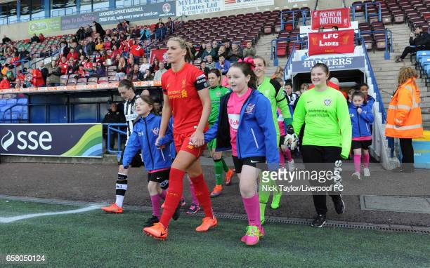 Captain Gemma Bonner of Liverpool Ladies leads her team onto the pitch at the start of SSE FA Women's Cup match between Liverpool Ladies and Notts...