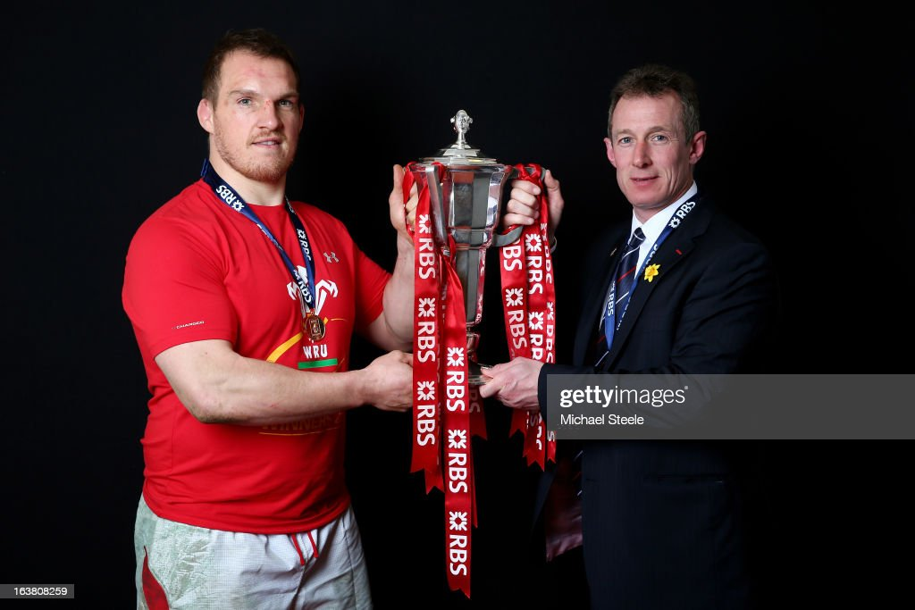 Captain <a gi-track='captionPersonalityLinkClicked' href=/galleries/search?phrase=Gethin+Jenkins&family=editorial&specificpeople=221481 ng-click='$event.stopPropagation()'>Gethin Jenkins</a> and Interim coach <a gi-track='captionPersonalityLinkClicked' href=/galleries/search?phrase=Rob+Howley&family=editorial&specificpeople=215419 ng-click='$event.stopPropagation()'>Rob Howley</a> pose with the Six Nations trophy following his team's victory during the RBS Six Nations match between Wales and England at Millennium Stadium on March 16, 2013 in Cardiff, Wales.