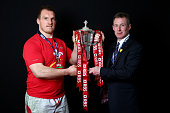 Captain Gethin Jenkins and Interim coach Rob Howley pose with the Six Nations trophy following his team's victory during the RBS Six Nations match...