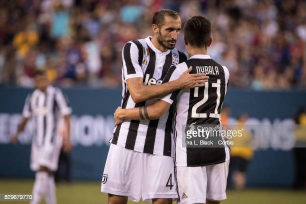 Captain Giorgio Chiellini of Juventus hugs Paulo Dybala of Juventus after the International Champions Cup match between FC Barcelona and Juventus at...