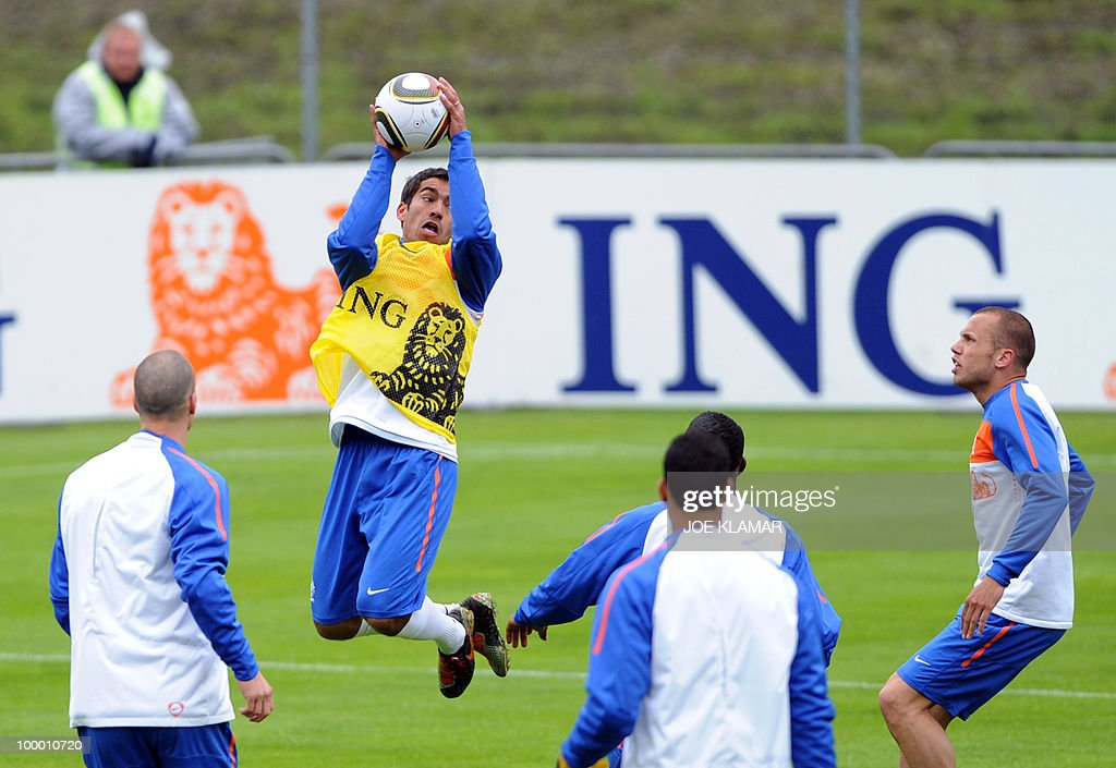 Captain Giovanni Van Brockhorst (2nd L) jumps with a ball during the Dutch national football team's first practice at their training camp in Tyrolian village in Seefeld on May 20, 2010, prior to the FIFA World cup 2010 in South Africa.