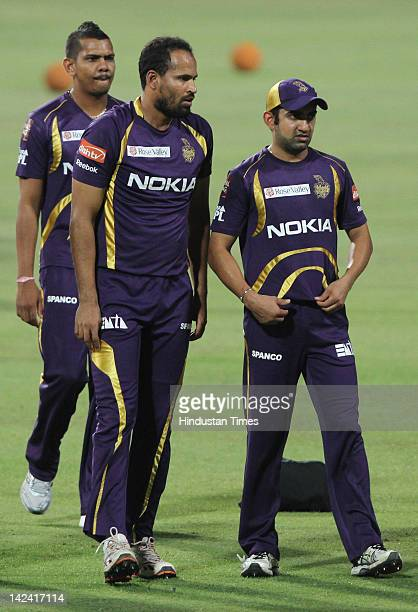 Captain Goutam Gambhir of Kolkata Knight Riders with teammates Yusuf Pathan and Sunil Narine during net practice at Eden Gardens on April 4 2012 in...