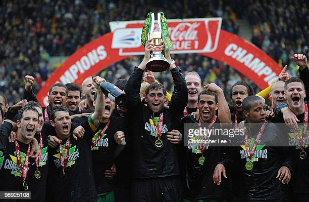Captain Grant Holt of Norwich City lifts the CocaCola League One trophy after the CocaCola League One match between Norwich City and Carlisle United...