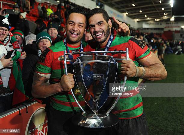 Captain Greg Inglis and John Sutton of South Sydney Rabbitohs of South Sydney Rabbitohs celebrate with the trophy after victory in the World Club...