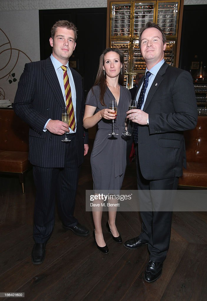 Captain Harris, Ellie Harris and Dylan Thomas show armed forces support at the 'Give Us Time' fundraiser held at Corinthia Hotel London on November 14, 2012 in London, England.