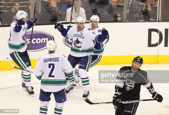 Captain Henrik Sedin of the Vancouver Canucks celebrates his third period goal as Jarret Stoll of the Los Angeles Kings looks on in Game Four of the...