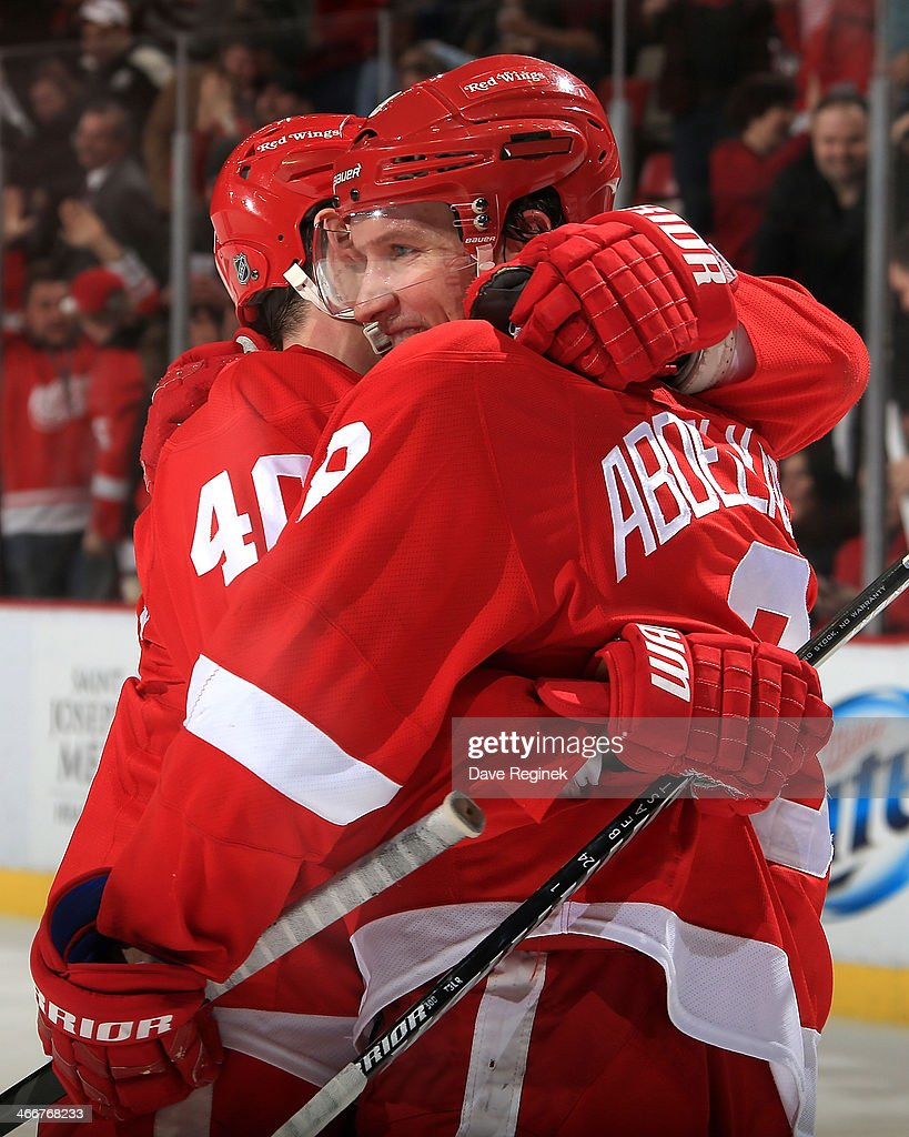 Captain <a gi-track='captionPersonalityLinkClicked' href=/galleries/search?phrase=Henrik+Zetterberg&family=editorial&specificpeople=201520 ng-click='$event.stopPropagation()'>Henrik Zetterberg</a> #40 of the Detroit Red Wings hugs teammate <a gi-track='captionPersonalityLinkClicked' href=/galleries/search?phrase=Justin+Abdelkader&family=editorial&specificpeople=2271858 ng-click='$event.stopPropagation()'>Justin Abdelkader</a> #8 after scoring an empty net goal, his second of the NHL game against the Vancouver Canucks to seal the victory on February 3, 2014 at Joe Louis Arena in Detroit, Michigan. Detroit defeated Vancouver 2-0.