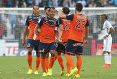 Captain Hilton of Montpellier Herault FC celebrate the victory with team mattes during the French Ligue 1 between Olympique de Marseille FC and...