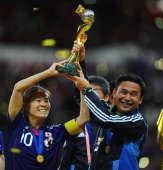 Captain Homare Sawa and coach Norio Sasaki of Japan lift the FIFA Women's World Cup at the end of the FIFA Women's World Cup 2011 Final match between...