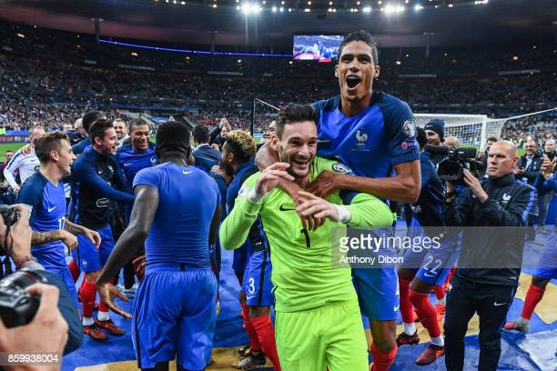 Captain Hugo Lloris of France and Raphael Varane of France celebrate the victory during the Fifa 2018 World Cup qualifying match between France and...