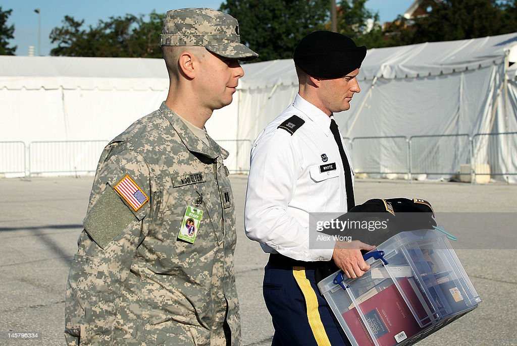 Captain Hunter Whyte (R), a member of the prosecution team, arrives for a motion hearing in the case United States vs. Pfc. Bradley E. Manning June 6, 2012 in Fort Meade, Maryland. Manning, an Army intelligence analyst who has been accused of passing thousands of diplomatic cables and intelligence reports to the whistleblowing website WikiLeaks and facing 22 charges including aiding the enemy, returned to the court room to ask for dismissal of 10 of the charges.