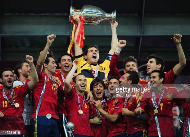 Captain Iker Casillas of Spain lifts the trophy after victory during the UEFA EURO 2012 final match between Spain and Italy at the Olympic Stadium on...