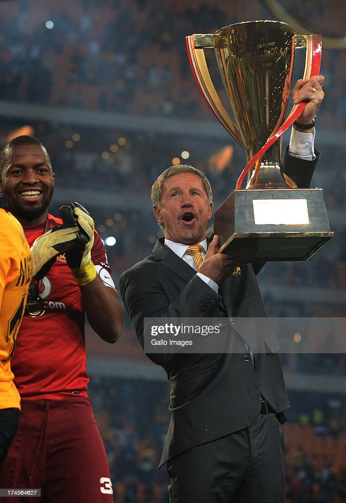 Captain Itumeleng Khune and head coach Stuart Baxter of the Kaiser Chiefs celebrate as they lift the trophy during the Carling Black Label Cup match...