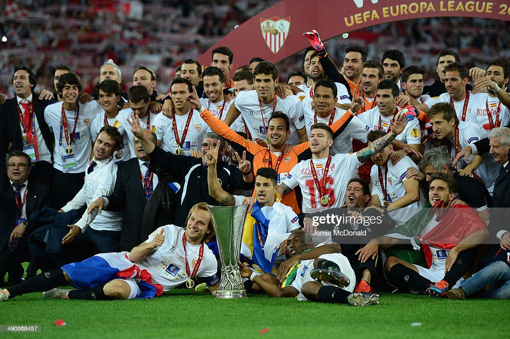 Captain Ivan Rakitic of Sevilla (C) celebrates with team mates after victory during the UEFA Europa League Final match between Sevilla FC and SL Benfica at Juventus Stadium on May 14, 2014 in Turin, Italy.
