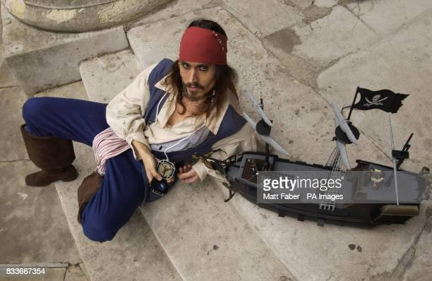 'Captain Jack Sparrow' aka Carmelo Masi demonstrates some of the 'Pirates of the Caribbean' toys