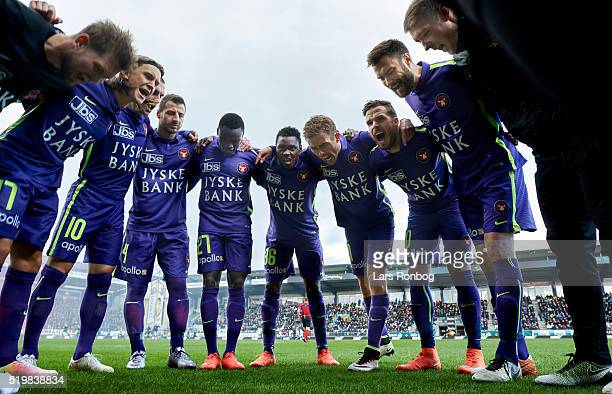 Captain Jakob Poulsen of FC Midtjylland and his teammates huddle prior to the Danish Alka Superliga match between Viborg FF and FC Midtjylland at...