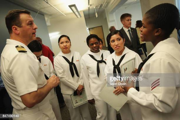 Captain James Hawkins Commanding Officer of Naval Station Great Lakes speaks with sailors under his command after they were sworn in as US Citizens...