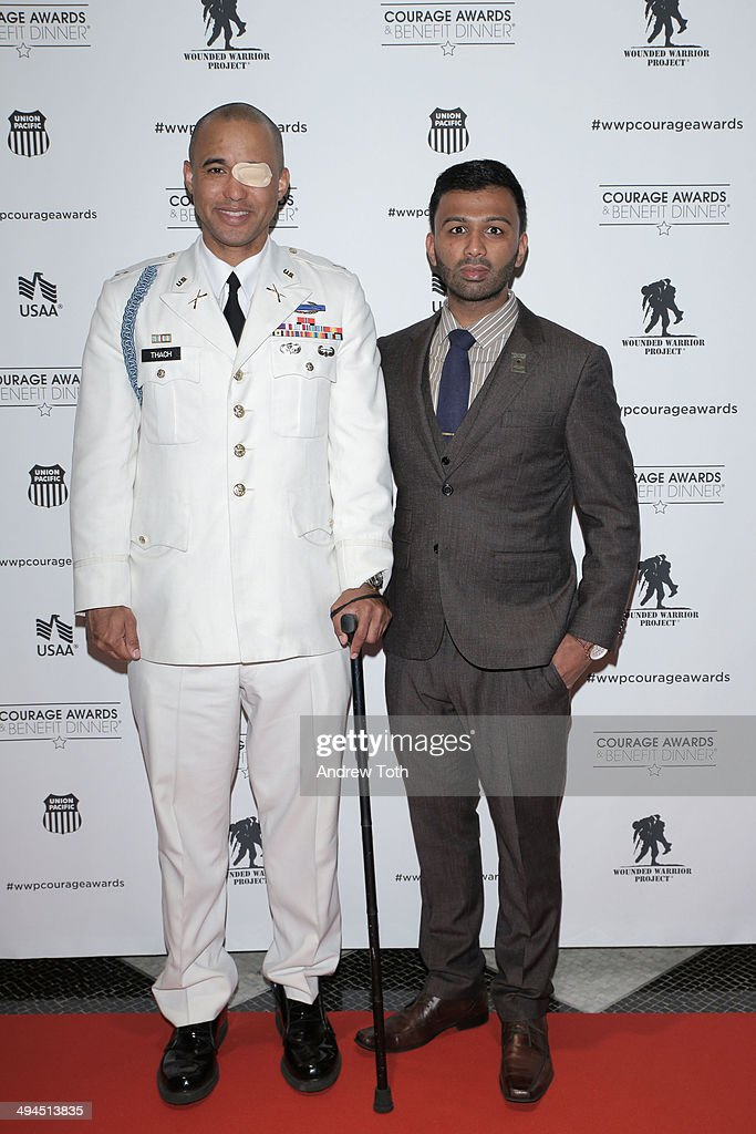 Captain James Van Thach (L) and Ali Malik attend the 9th annual Wounded Warrior Project Courage Awards & Benefit Dinner at The Waldorf=Astoria on May 29, 2014 in New York City.