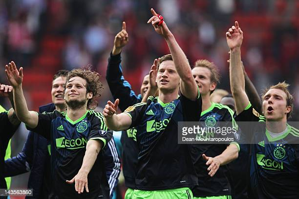 Captain Jan Vertonghen leads as the Ajax players celebrate in front of their fans after victory in the Eredivisie match between FC Twente and Ajax...