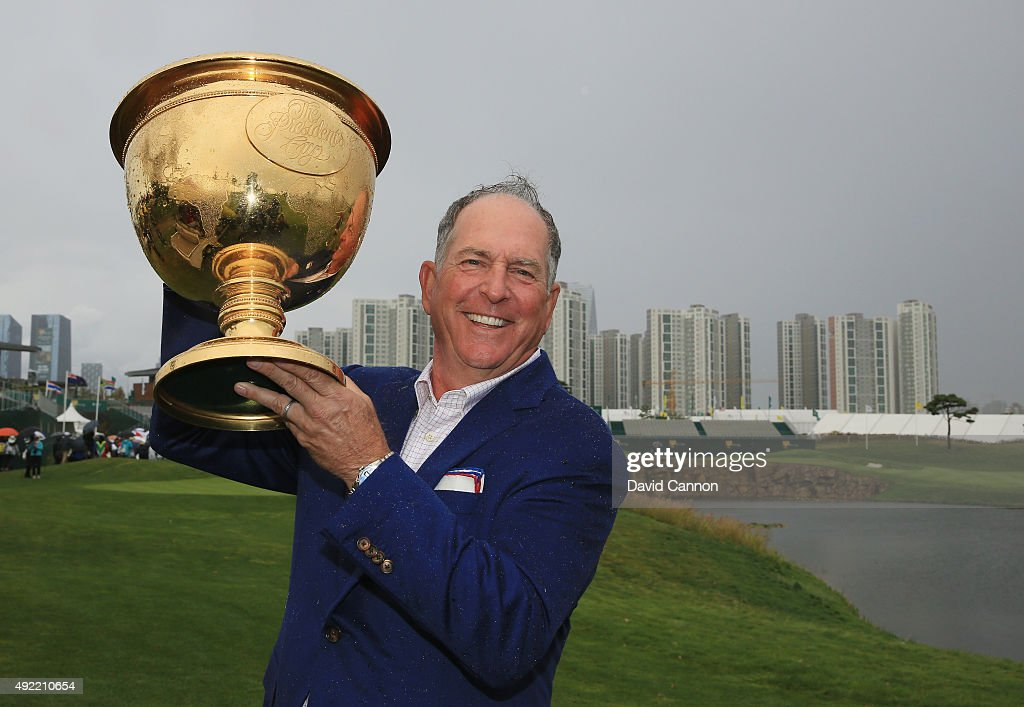 Captain Jay Haas of the United States Team poses with the Presidents Cup after the United States defeated the International Team 155 to 145 after the...