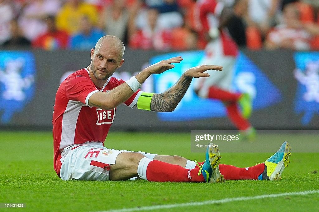 Captain Jelle Van Damme #37 of Standard de Liege gestures from the turf during a Europa League match against KR Reykjavik on July 25 , 2013 in Liege, Belgium.