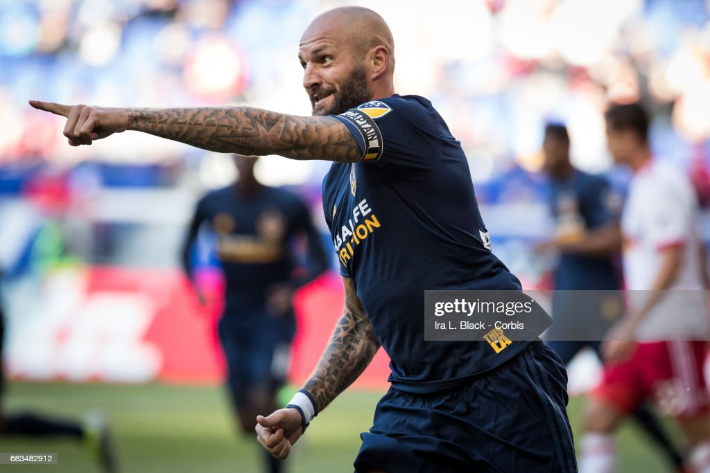 Captain Jelle Van Damme #37 of the LA Galaxy points to teammate Romain Alessandrini #7 after he scored the goal during the MLS match between LA Galaxy vs New York Red Bulls at Red Bull Arena on May 14, 2017 in Harrison, NJ. The LA Galaxy won the match with the score of 3 to 1.