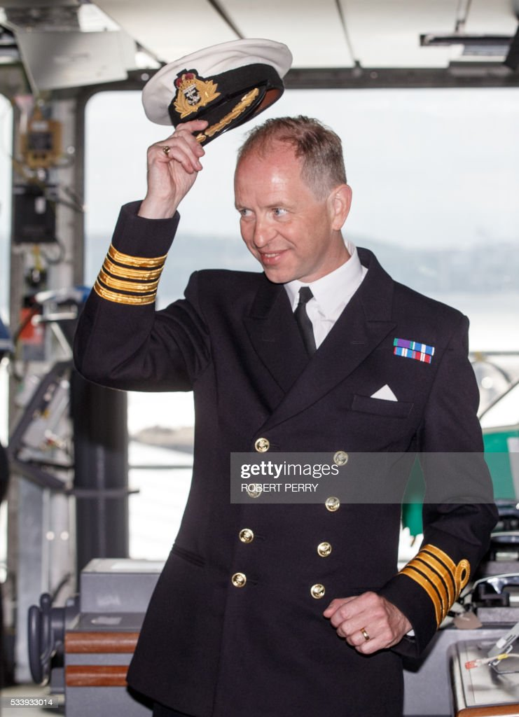 Captain Jerry Kyd, the first Commanding Officer of British aircraft carrier HMS Queen Elizabeth poses for a photograph on the bridge of the 65,000-tonne ship in Rosyth dockyard in Scotland, on May 24, 2016. / AFP / Robert Perry