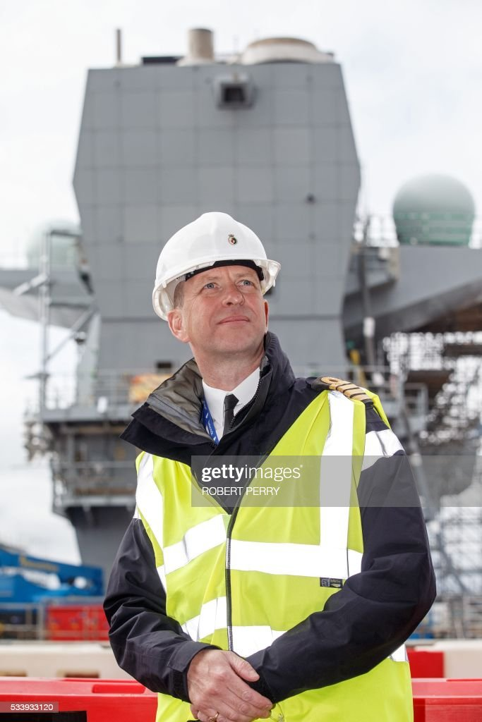 Captain Jerry Kyd, the first Commanding Officer of British aircraft carrier HMS Queen Elizabeth poses for a photograph on the deck of the 65,000-tonne ship in Rosyth dockyard in Scotland, on May 24, 2016. / AFP / Robert Perry