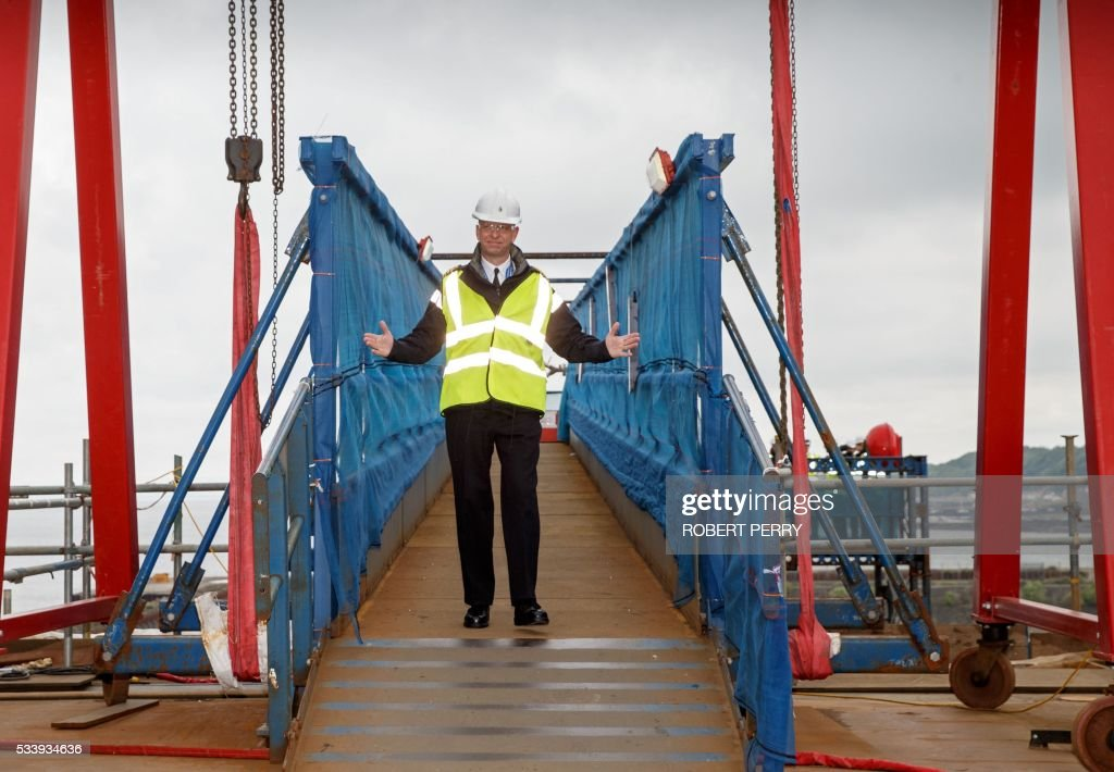 Captain Jerry Kyd, the first Commanding Officer of British aircraft carrier HMS Queen Elizabeth poses for a photograph as he arrives on the deck of the 65,000-tonne ship in Rosyth dockyard in Scotland, on May 24, 2016. / AFP / Robert Perry