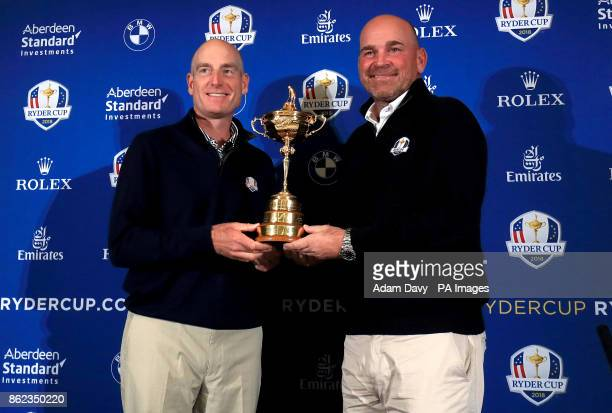USA captain Jim Furyk and European captain Thomas Bjorn hold the Ryder Cup during a media event ahead of the 2018 Ryder Cup at The Hotel Pullman...