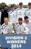 Captain Jimmy Adams bottom left and Sean Ervine and the Hampshire team and staff celebrate with the trophy after winning the Division Two...